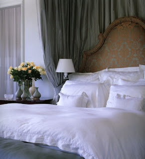 Matching upholsted bed head with cushions, valance and curtains makes a very comfortable bedroom.