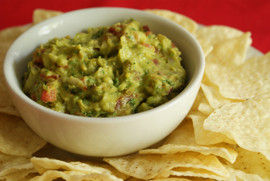 Guacamole made with fresh tomatoes and red onion and cilantro.
