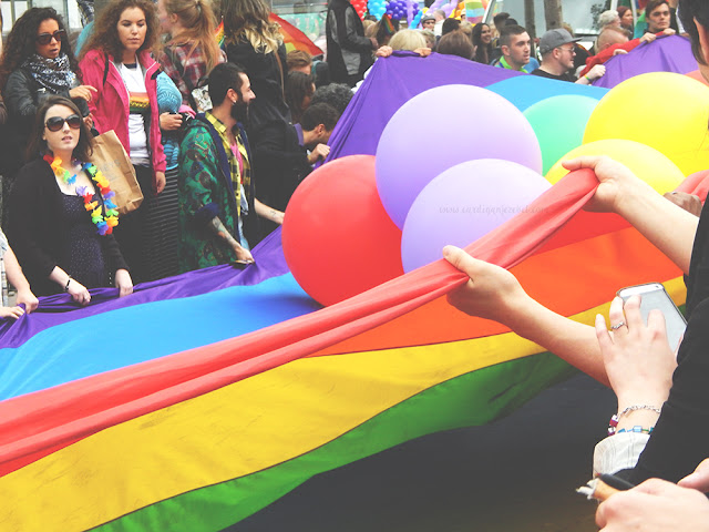 rainbow flag being held by people
