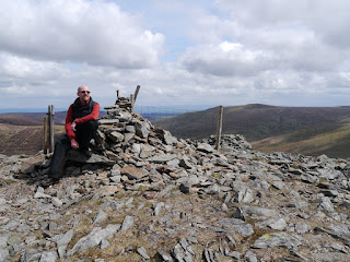 On the summit of Great Calva, my final Wainwright in the Northern Fells