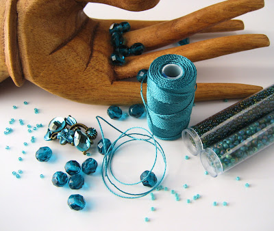 My palette for the teal crystal slider bracelet with C-lon cord, seed beads, and delicas.