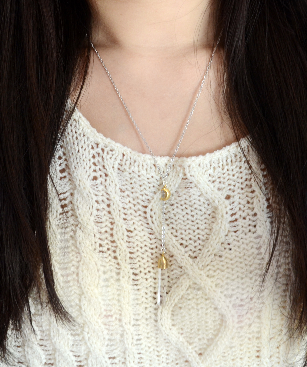 The Moon Princess necklace, modeled with a cream-colored sweater.