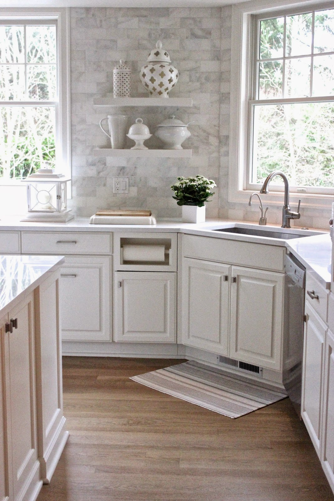 the countertops are white quartz and the backsplash