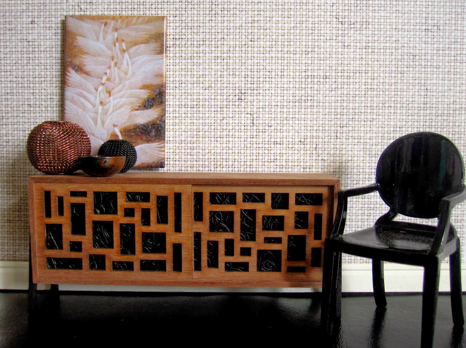 Modern miniature scene with mid-century sideboard, black ghost chair and chinese print of geese in colours of brown and black