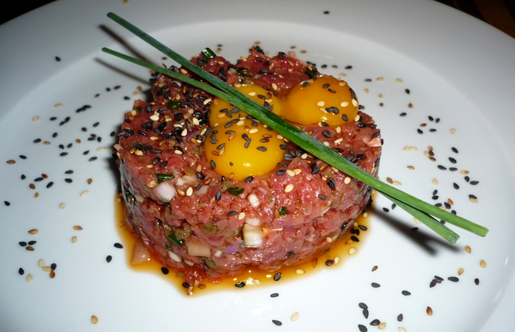 Beef tartare[tar-TAR]A dish of coarsely ground or finely chopped high ...