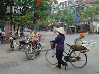 Woman with hat Vietnamese cycling