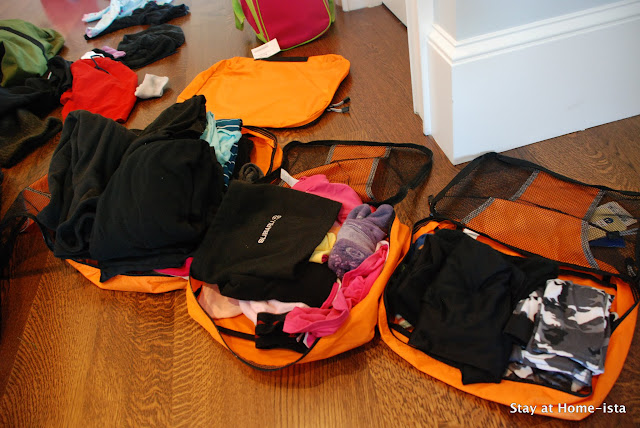 Packing ski clothes into packing cubes to keep everything organized