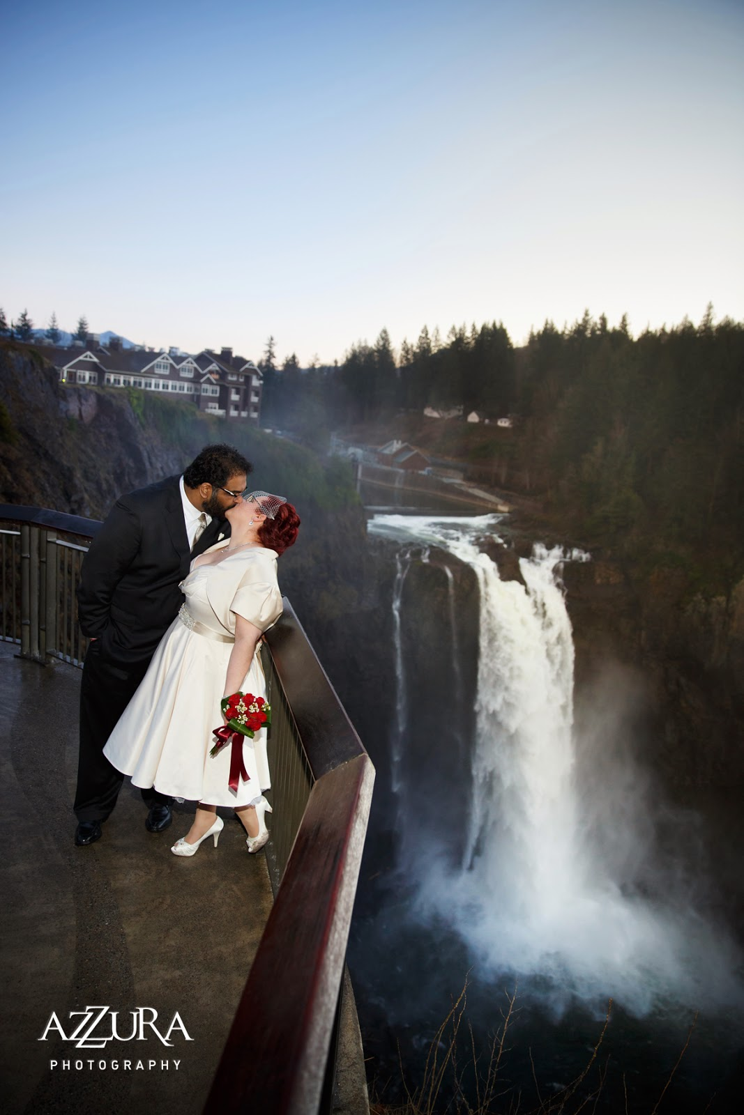 Newly married Abby and Ankur kiss at Snoqualmie Falls - Patricia Stimac, Seattle Wedding Officiant