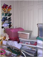 project boxes blocking closet doors in cluttered sewing room