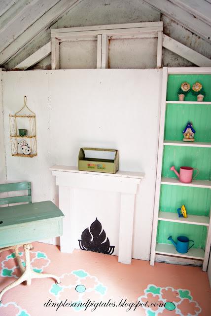 Faux chalkboard fireplace , vintage desk, painted floors