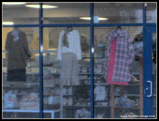Dressed in all pink thrift store front window