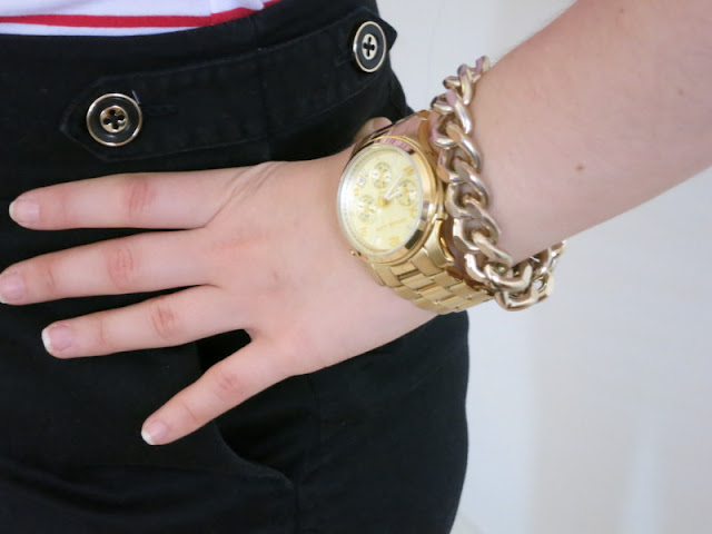 Gold watch and gold chain link bracelet