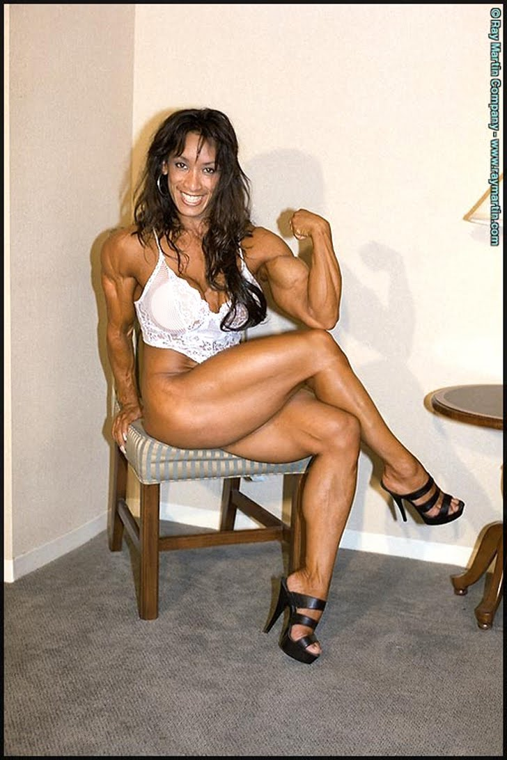 Denise Masino Flexing Her Bicep And Posing Her Muscular Legs In Heels