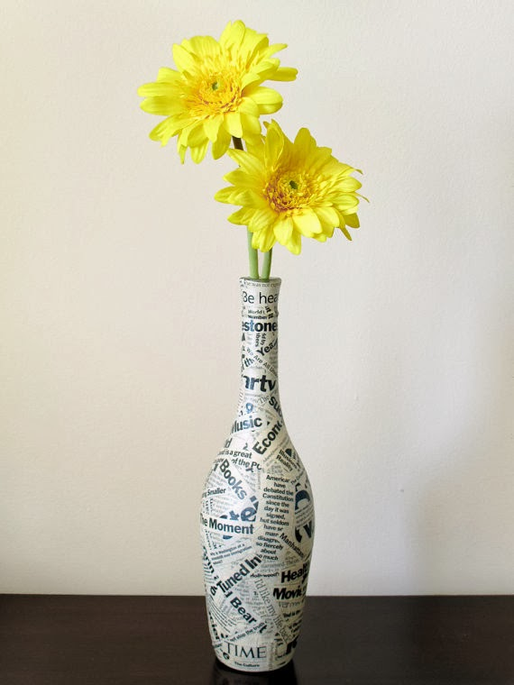 The art of up cycling upcycling bottles lamps chimes for Wine bottle flower vase