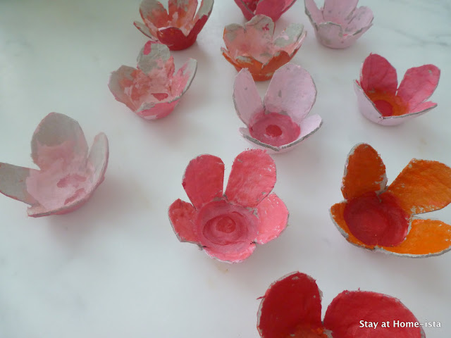 Use an egg crate to create cardboard cherry blossoms, then paint the with your kids. And easy spring DIY craft.