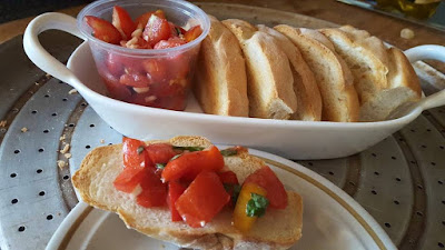Garden fresh bruschetta and home baked garlic crostini