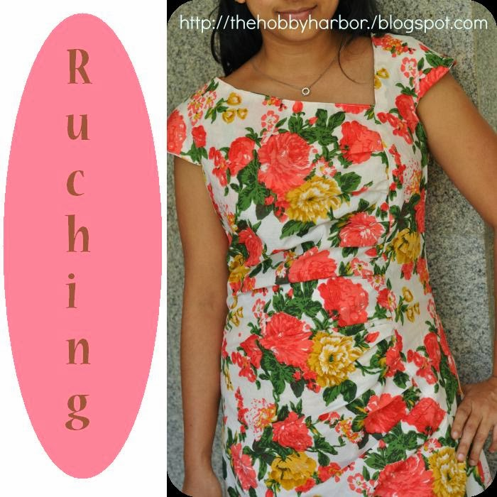 Floral fabric printed cotton dress with asymatrical ruching or gathers with zip at the back and cap sleeves