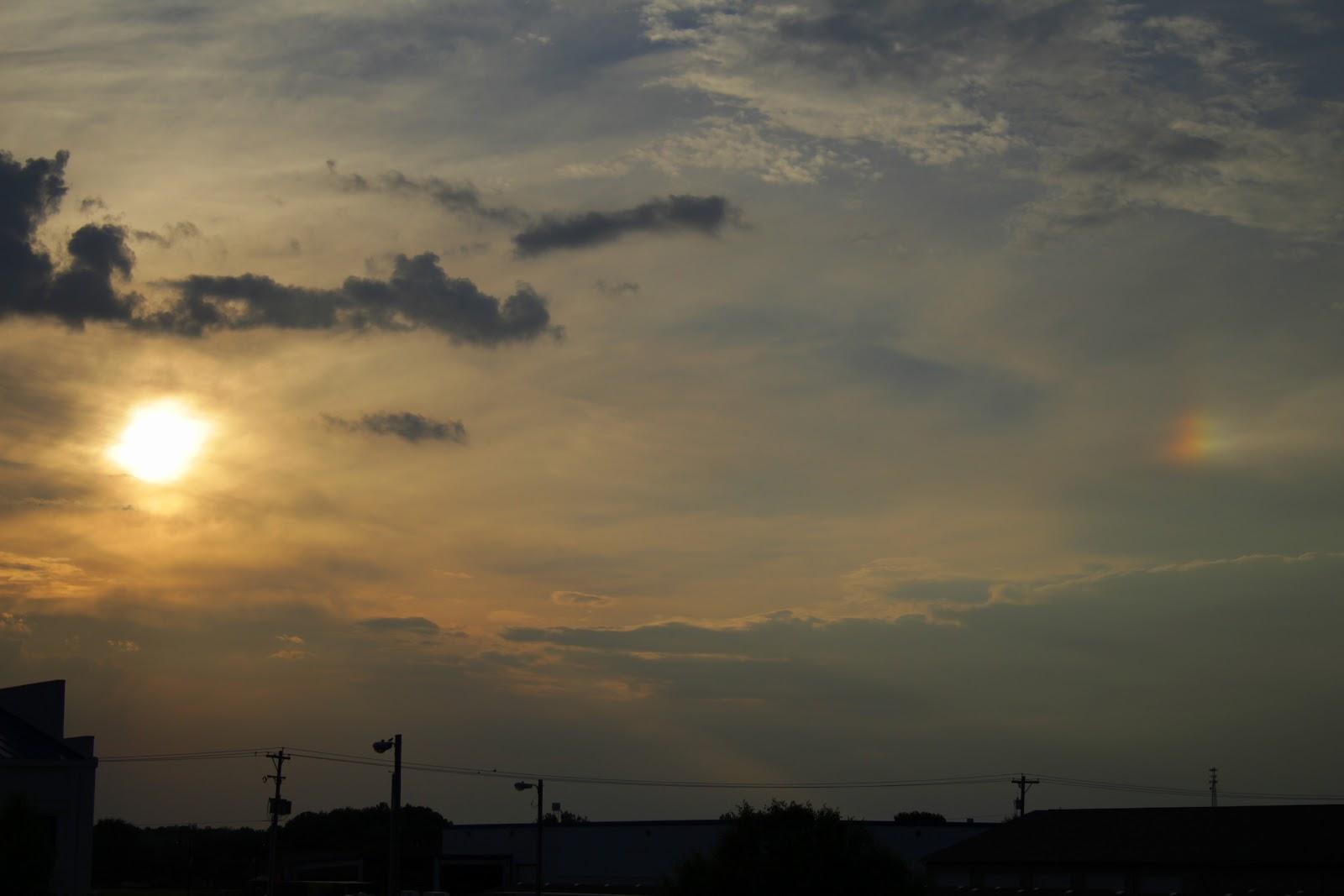 small rainbow near the sun