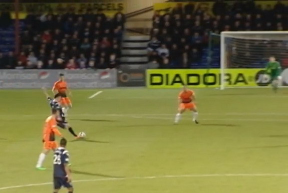 Ross County player Filip Kiss shoots to score his side's third goal against Dundee United