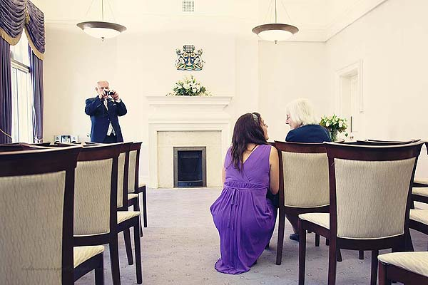 guest taking photos of other guests at Marylebone Town Hall Purple room