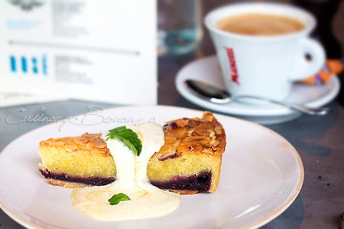 Sour Cherry Bakewell Tart berries, sweet almond filling, served with clementine rippled sour cream Cappuccino