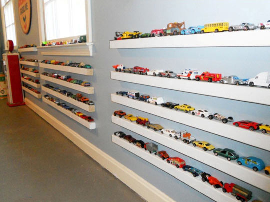 Picture ledge toy car storage by Lacey Carroll Interiors