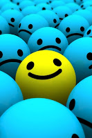 smiley faceamong sad faces=being different