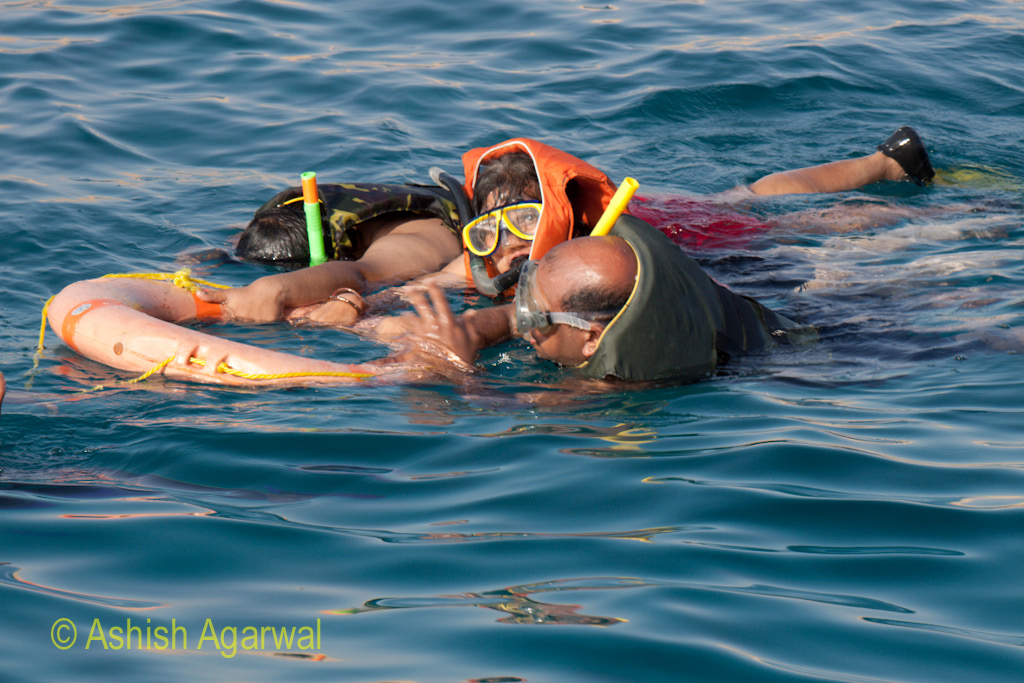 Tourists wearing snorkeling equipment and clutching a rubber tube in the Ras Muhammed park
