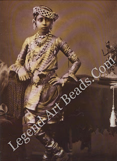 The jaunty pose of a young western Indian prince belies the weight of both his jewels and his responsibilities of state.