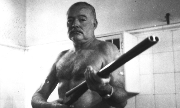 Ernest Hemingway with shotgun angry shirtless