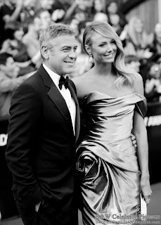 George Clooney and Stacy Kleiber over red carpet at 2012 Academy Awards - Oscar arrival