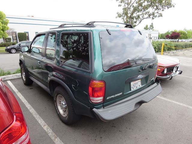 Collision damage to quarter panel and bumper on Ford Explorer