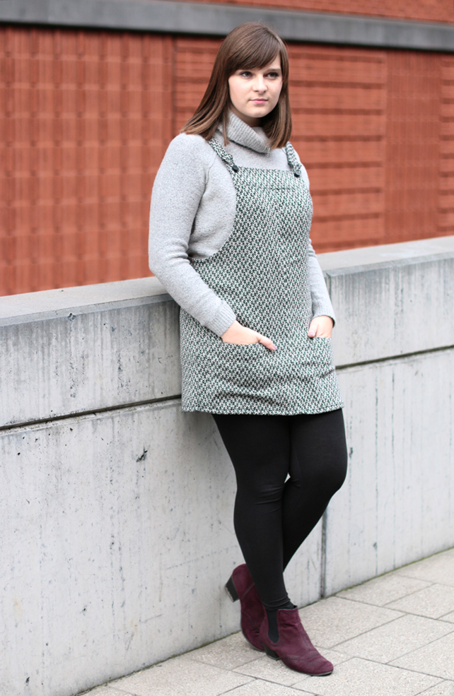 combine turtleneck sweater and pinafore dress
