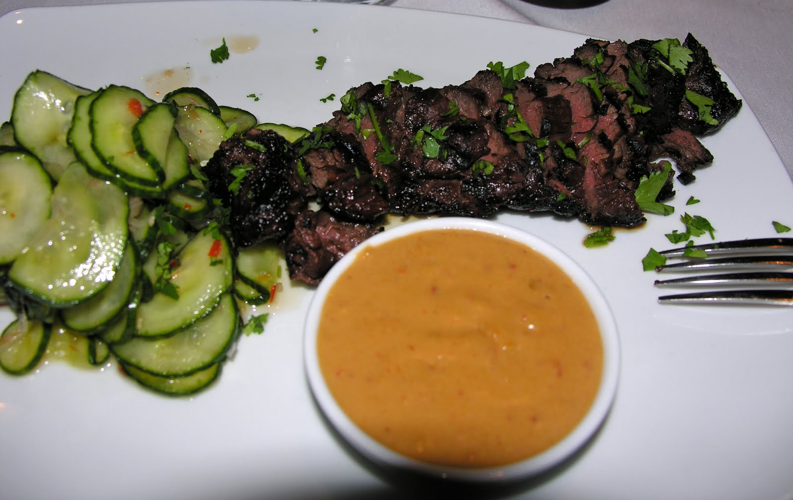 My hanger steak with cucumber salad and spicy peanut sauce.