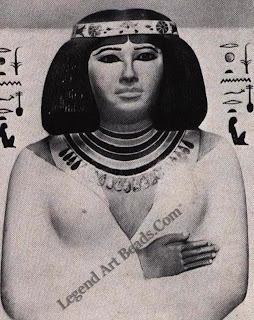 Painted limestone statue of Nofret wearing a cloisonné silver circlet and a Broad Collar of headstone beads. IIIrd lVth Dynasty Cairo Museum