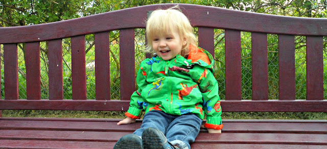 toddler on a bench