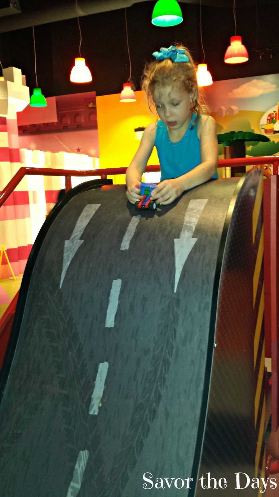 Girl racing Lego car track at Legoland Discovery Center in Grapevine