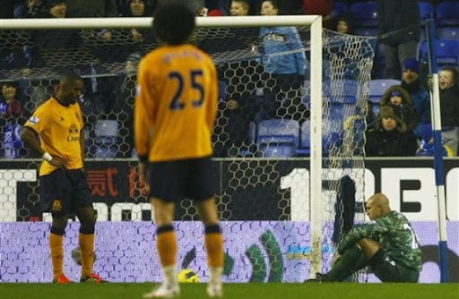 Everton goalkeeper Tim Howard reacts after conceding a bizarre own goal against Wigan