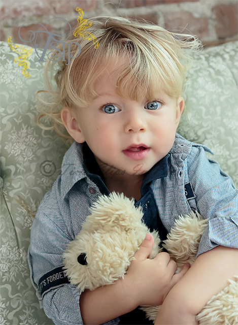 Blue_Eyed_Toddler_with_Teddy_Bear