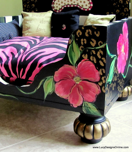 floral stripes and animal print dog bed with zebra cushions and carved wooden feet