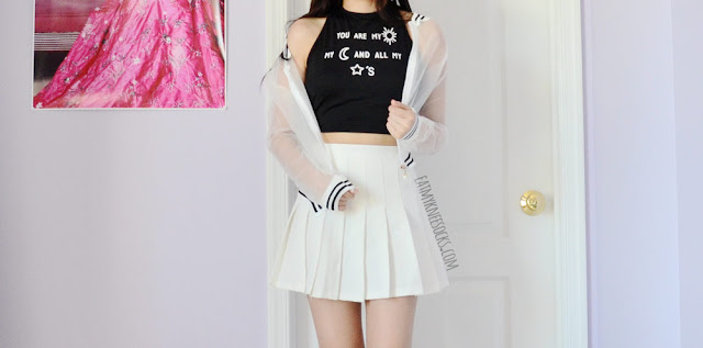 A ulzzang grunge-rock outfit featuring Dresslink's sheer striped bomber jacket and halter crop top, worn with a white pleated American Apparel tennis skirt.
