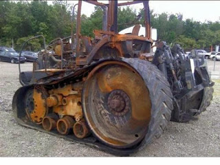 Salvaged Cat MT765 tractor parts