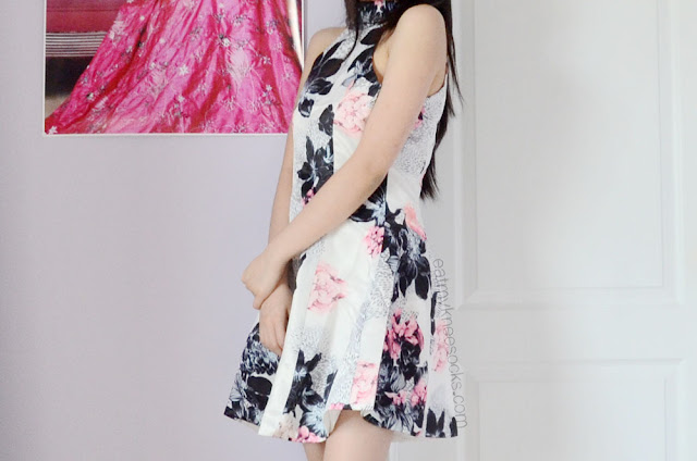 Romwe's floral halter skater dress is perfect for picnics, graduation, summer parties, and spring gatherings.
