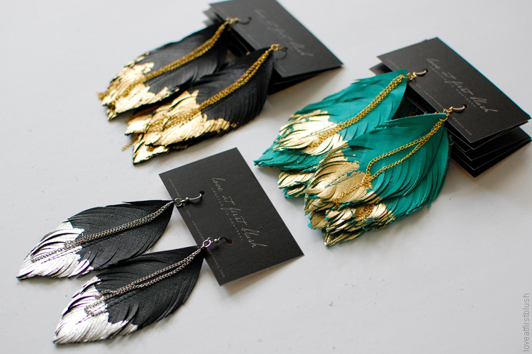 leather feather earrings by Love at First Blush in gold and turq 