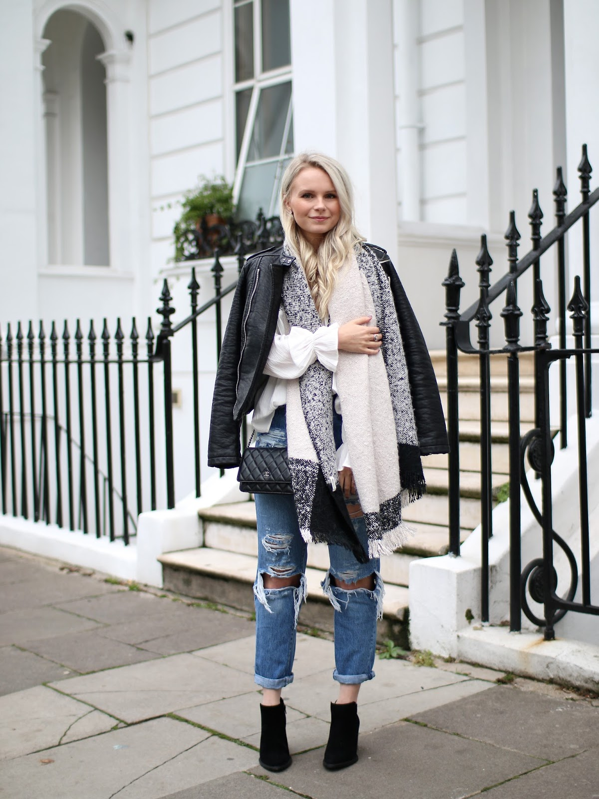 a blogger demonstrates how to style a casual and simple outfit for a cold day in london