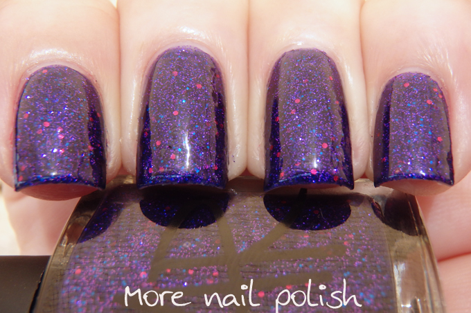 Crystal Mystery A Full Coverage Glitter Jelly With Blackened Blue Base Aqua Glitters In Various Sizes And Purple Square