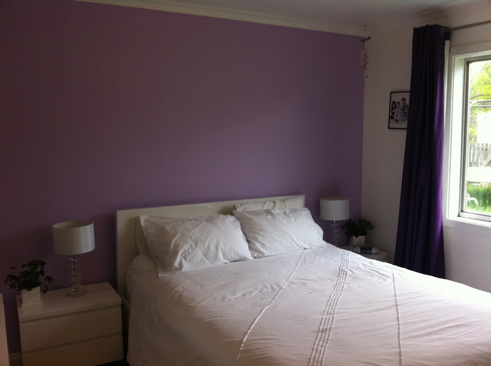My old room in my parent s home living loving hobart for Purple feature wallpaper living room