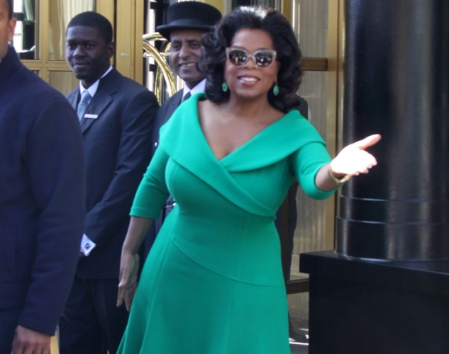 Oprah Winfrey in green vintage dress with cat eye glasses and retro hair via Lexi DeRock of Voluptuous Vintage Vixen