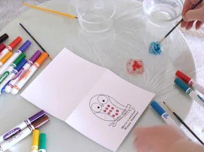 Place wet paintbrush in crayola washable marker in gathered on plastic wrap