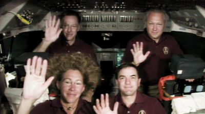 Atlantis – STS135 – The crew of Atlantis wave good-bye for the last time from the Space Shuttle at the end of an interview with the media. NASA-TV 2011.
